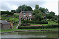 SJ6374 : Cottage with garden by the canal near Barnton, Cheshire by Roger  Kidd