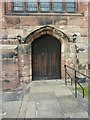 SJ6543 : Parish Church of St James the Great, Audlem, Doorway by Alexander P Kapp