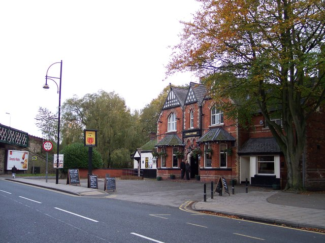 The Romiley Arms adjacent to the railway at Romiley