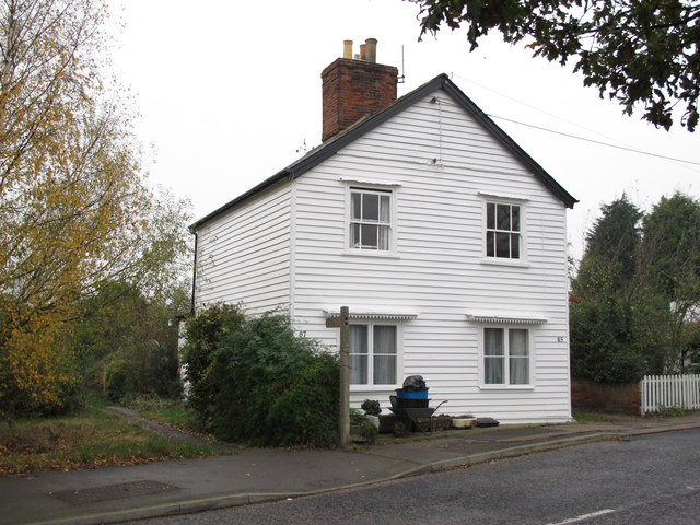 Footpath near weatherboarded house