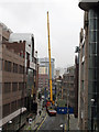 TQ3381 : Construction crane in Alie Street by Roger Jones