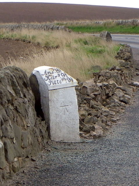 Milestone and bench mark near St Andrews