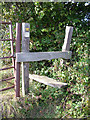 TL9561 : Footpath stile by John Goldsmith