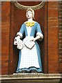 TQ3480 : The (former) Raine Street charity school, E1 - Bluecoat girl statue (2) by Mike Quinn
