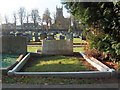 SE7971 : Grave in Norton Cemetery with view to St Peter's Church by Neil Theasby