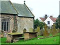 TA0579 : Eastern end of Folkton church and churchyard by Christine Johnstone