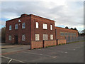 SP4640 : Partly boarded-up offices and factory by batologist