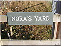 TM1975 : Nora's Yard sign by Adrian Cable