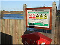 SK9166 : Sign and lake at Whisby Nature Park by PAUL FARMER