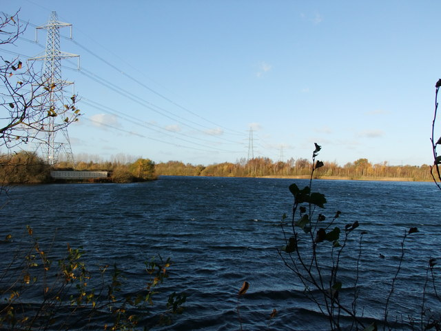 Pylons crossing lake at Whisby Nature Park