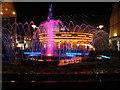 TL8564 : Dancing fountain, carousel, and illuminated Debenhams by John Goldsmith