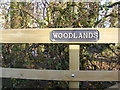 TM2569 : Woodlands sign by Adrian Cable