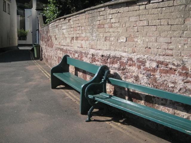 Two seats by a wall, east end of Riverside