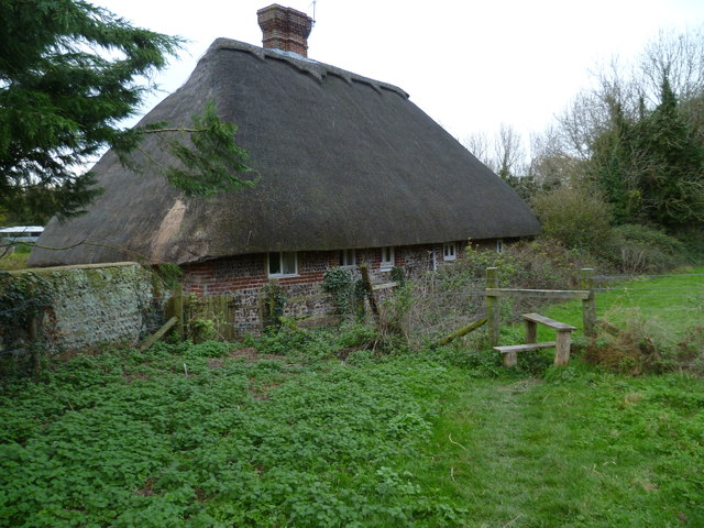 Footpath reaches cottage at Wepham