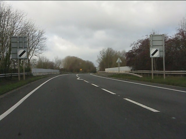 A51 crosses the West Coast railway line