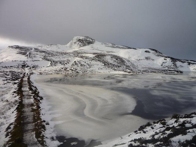Meall na h-Aodainn Mòire across a partially frozen Loch a' Choire