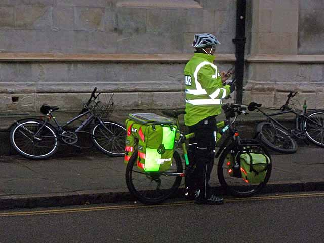 Cycling paramedic, Trumpington Street, Cambridge