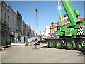 SP3165 : Big green crane lowers a precast wall section by Robin Stott