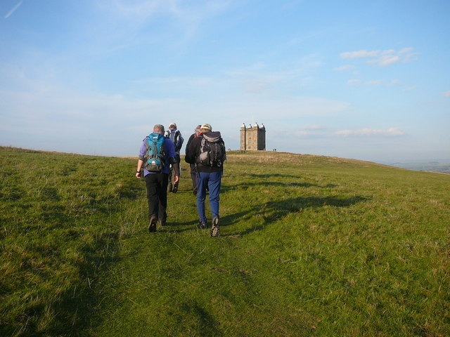 Walking group heading towards The Cage in Lyme Park