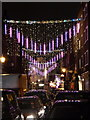 TQ2981 : London: Christmas lights in Earlham Street by Chris Downer
