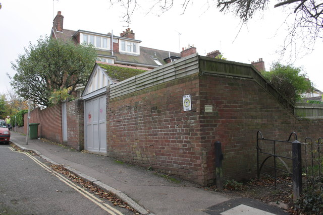 Side wall of #26 Velwell Road and rear footpath