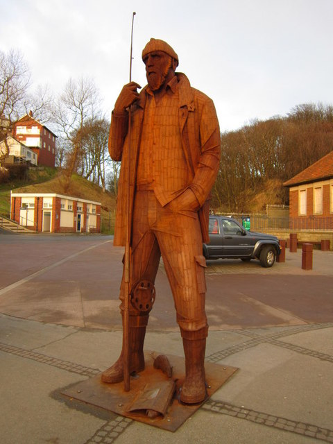 High tide in short wellies sculpture, Filey