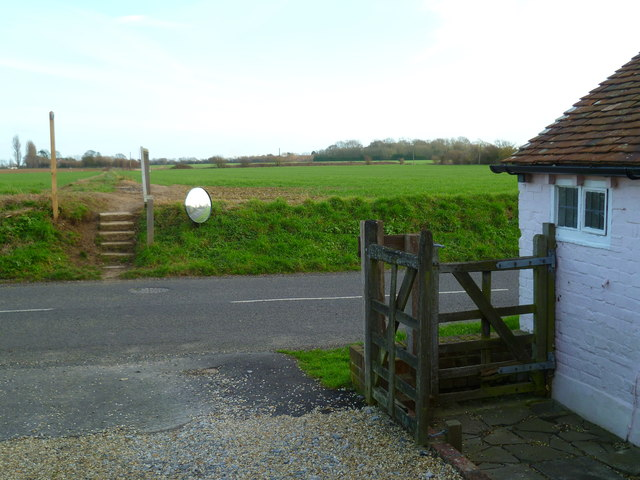 Footpath crosses Taylor's Lane and continues through field