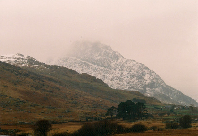 Rough ground looking towards a snowy Tryfan