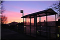 NT5035 : A bus shelter in silhouette by Walter Baxter