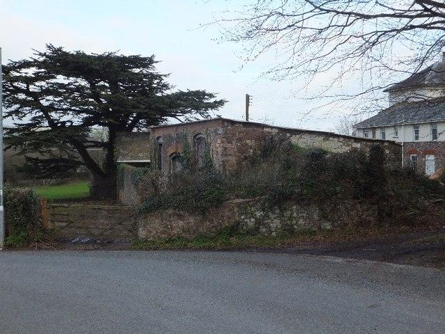 Farm buildings and cedar at Tidcombe Hall