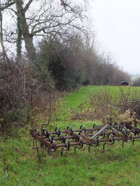 Harrow in the corner of field near Burrow Corner