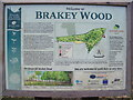 TM1977 : Information Board at the entrance to Brakey Wood by Adrian Cable