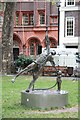 TQ2981 : Statue, Soho Square - Man & child by John Salmon