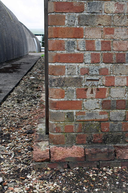 Benchmark on building next to Unit 43