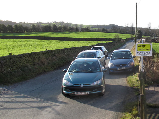 Cars waiting at a level crossing