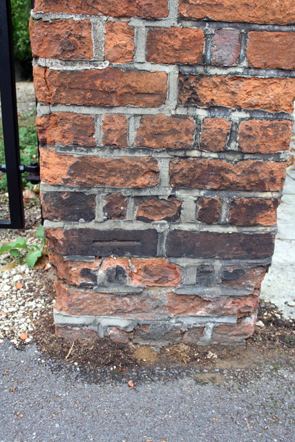 Benchmark on the gatepost of #215 Woodstock Road