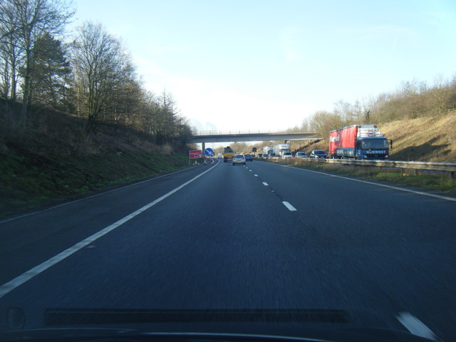 M56 passes under Rake Lane