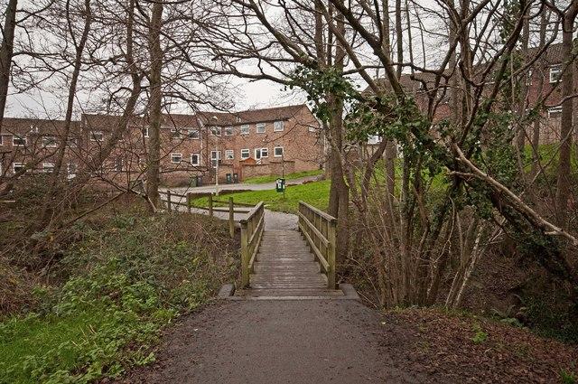 A footbridge & cyclepath crossing Coney Gut