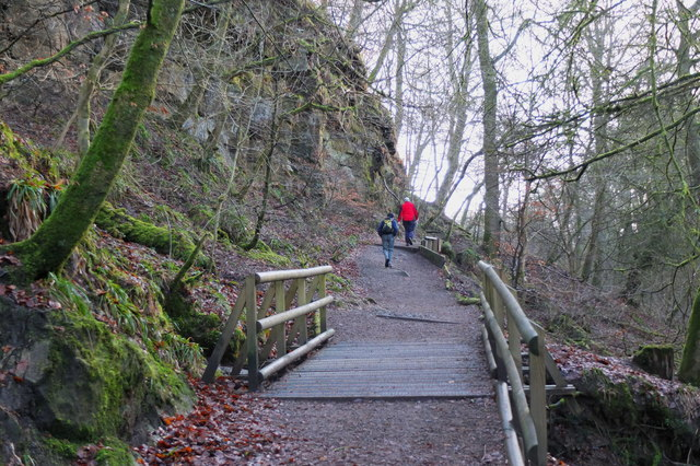 Path below rock outcrops, Calderglen Country Park