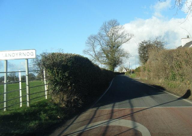 Llandyrnog village sign on lane