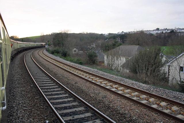 Charter train waits at signal