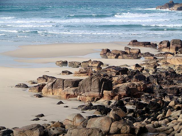 Rocks and sand at the north end of Whitesands Bay