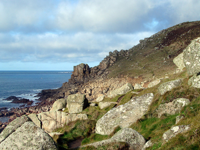 The South West Coastal Path climbs up from the beach towards Carn Aire