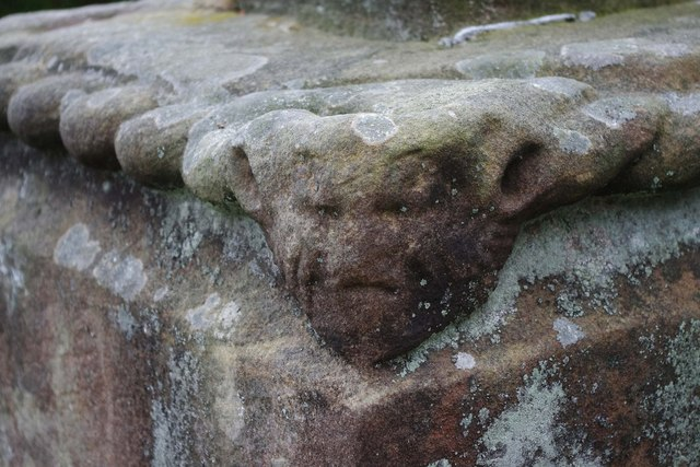 St. Cuthbert's Church (6) - carved head on remains of old cross, Rectory Road, Donington