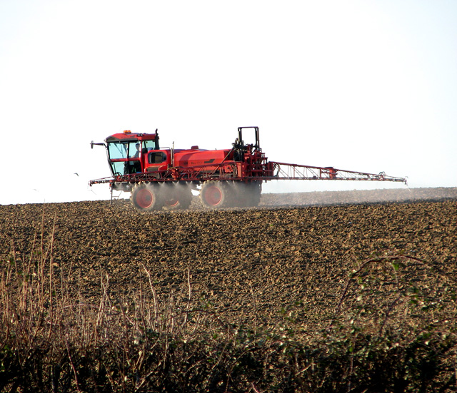 Crop spraying in field south of Session Wood, Easton