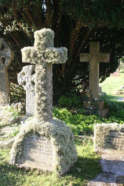 A lichen covered granite cross in Mawnan churchyard