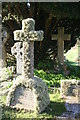 SW7827 : A lichen covered granite cross in Mawnan churchyard by Rod Allday