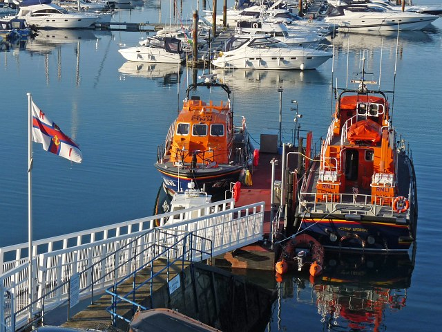 Lifeboats moored in Brixham Harbour.
