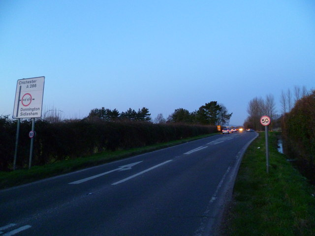 The A286 approaching the junction with Wophams Lane