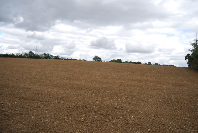 Large ploughed field near Clayden Hall